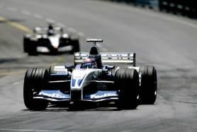 2003 Monaco Grand Prix Monte Carlo, Monaco. 29th May - 1st June 2003 Juan-Pablo Montoya, BMW Williams FW25, leads Kimi Raikkonen, Team McLaren Mercedes MP4-17D, action. Photo: Photo: LAT Photographic ref: 35mm Image 03Mon08