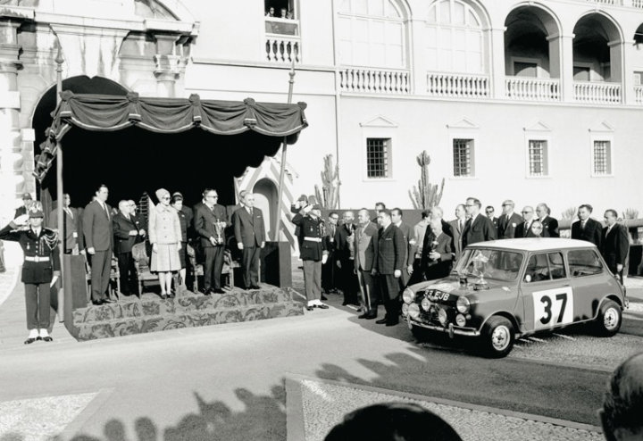 Hopkirk and Liddon taking the winners trophy at 1964 Rallye Monte Carlo
