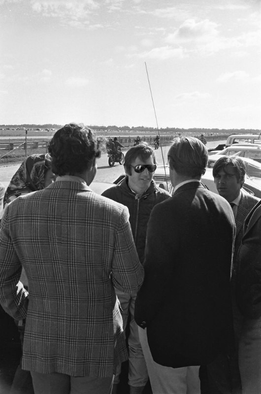 Peter Revson with friends in the Paddock at the 1972 Daytona 6-Hour Continental.  Considering how well dressed everyone was I didn't quite fit in with my Army field jacket and corner worker uniform. (Photo by Lou Galanos)