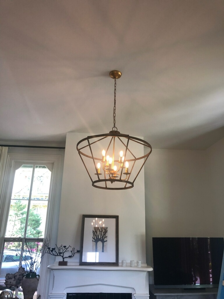 Raleigh, NC - Installing customer supplies chandelier in living room