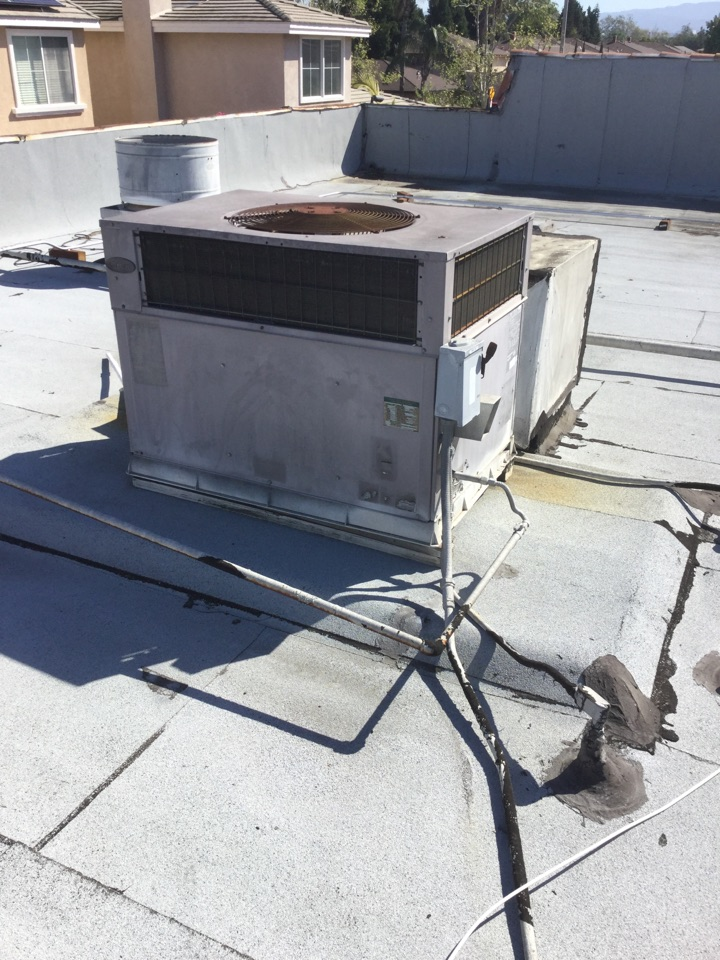 Santa Ana, CA - Inspecting electrical connection