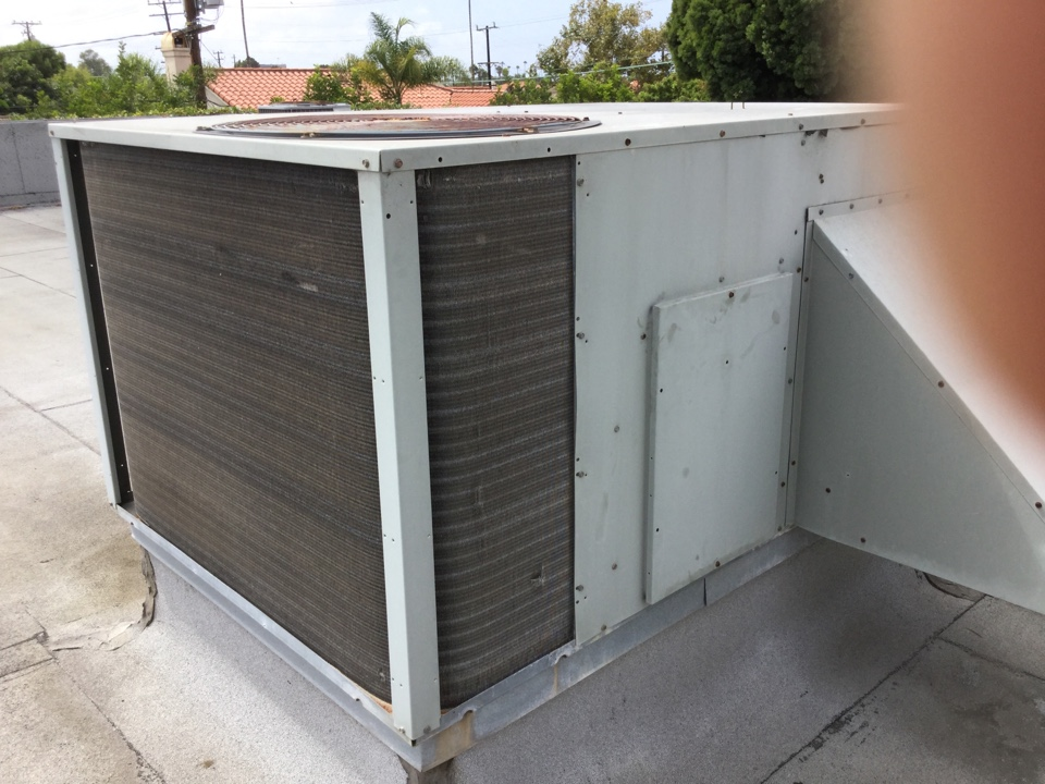 Costa Mesa, CA - Working on a package unit