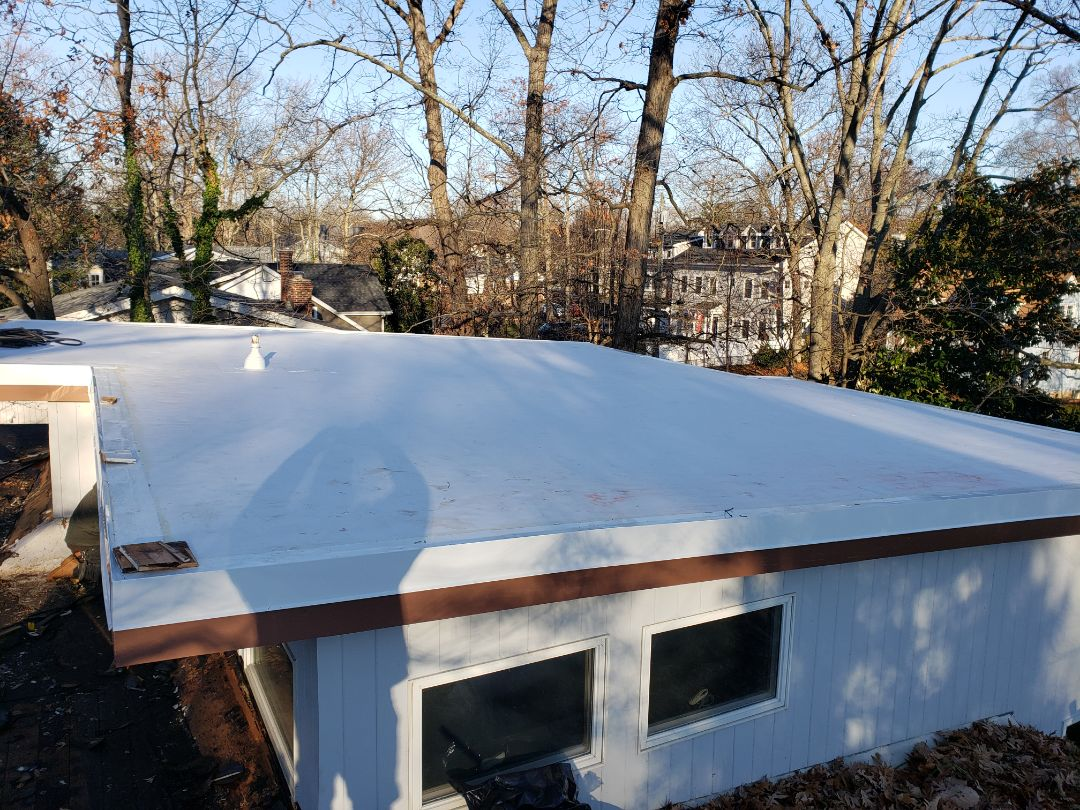Annapolis, MD - Installing new low slope membrane. Firestone TPO .060 white TPO roof system.