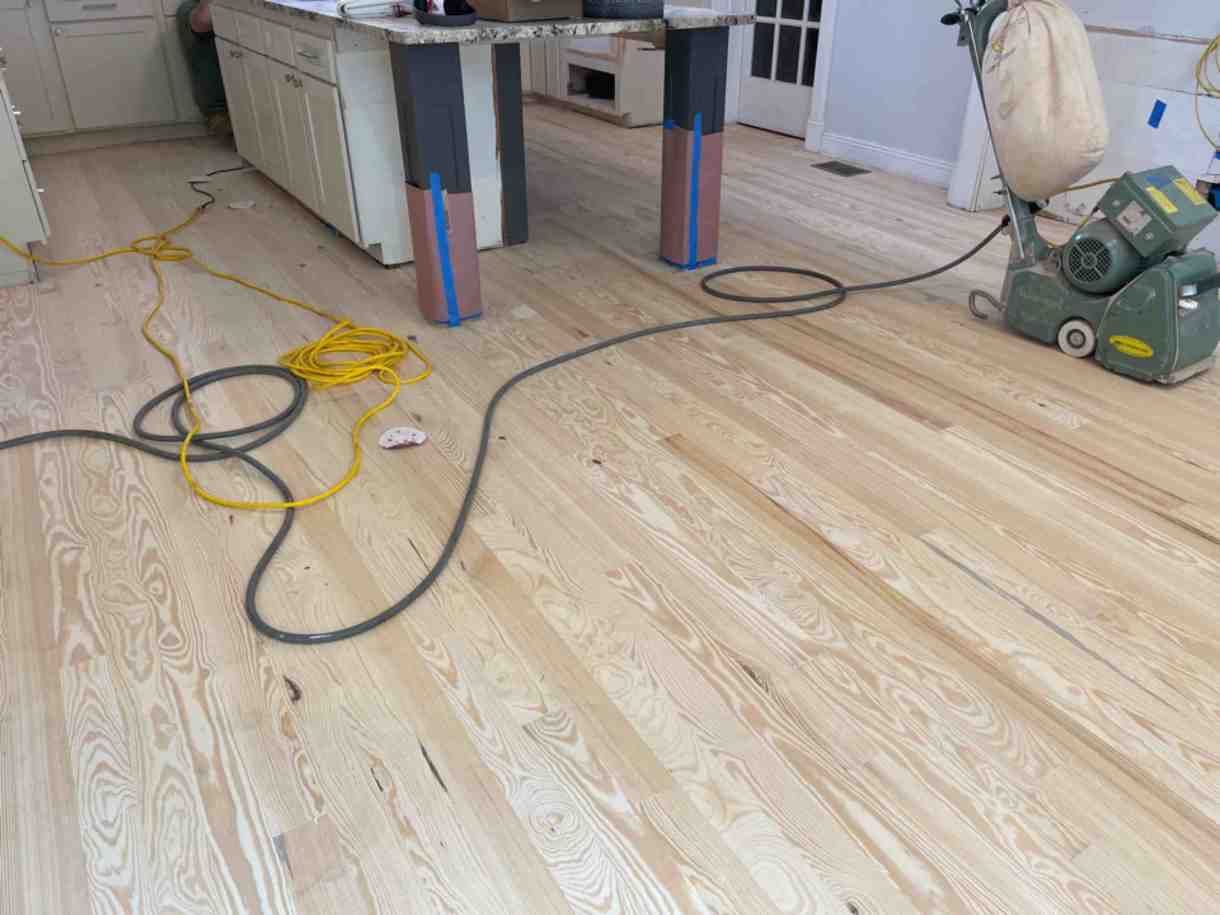 Sand, stain and finish yellow pine tongue and groove! Do you want beautiful floors? Call Troendle Hardwood Floor Company.
