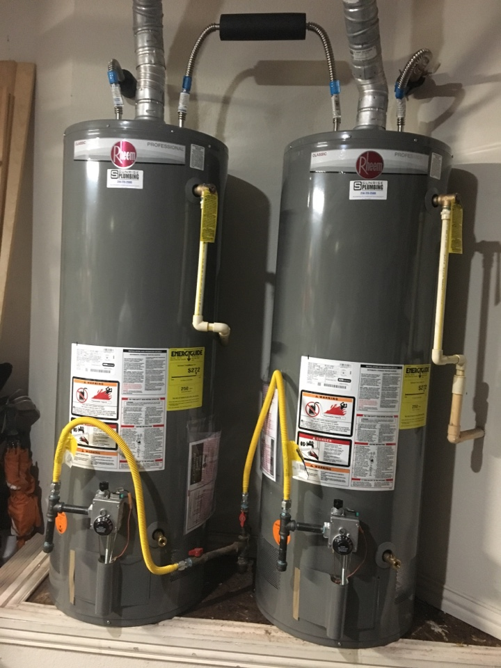 Allen, TX - American water heater leaking in garage. Install 2 new rheem water heaters