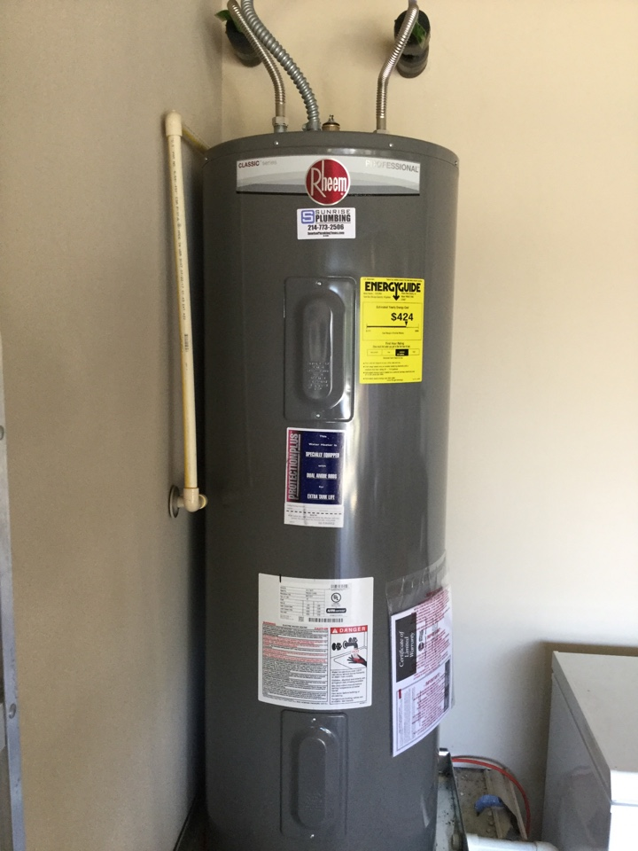 Forney, TX - 50 gallon electric water heater in garage is not producing hot water. Install new Rheem professional water gear with 4 year warranty extension. Forney plumbers
