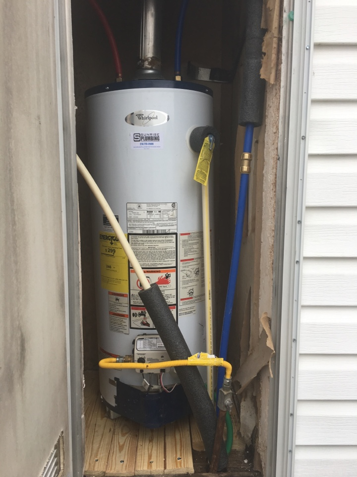 Wylie, TX - Homeowner had a gas water heater in outside closet, wood underneath was rotting. Homeowner wants to remove water heater, install new wood underneath, and reinstall water heater. Turned out really nice.