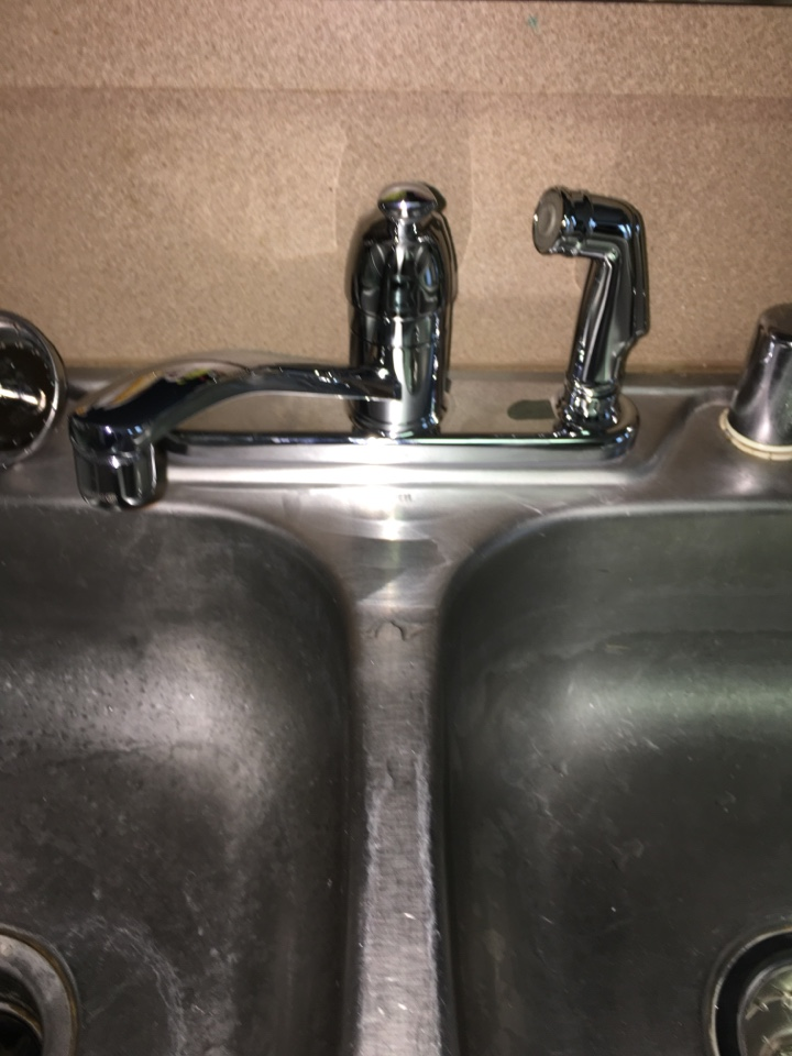 Royse City, TX - Kitchen sink faucet leaking. No faucet repair can be made. Install new Moen kitchen faucet. Install new kitchen sink basket strainer.