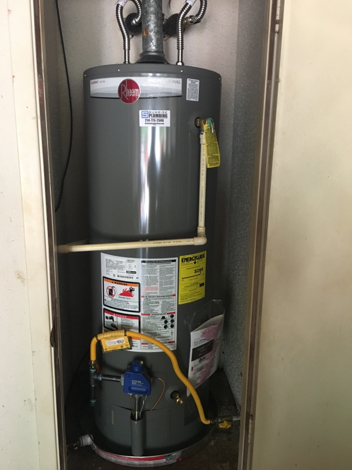 Rowlett, TX - Water heater leaking in garage. Needs replacement. Install new Rheem water heater in garage closet. Sunrise Plumbing in Rowlett TX