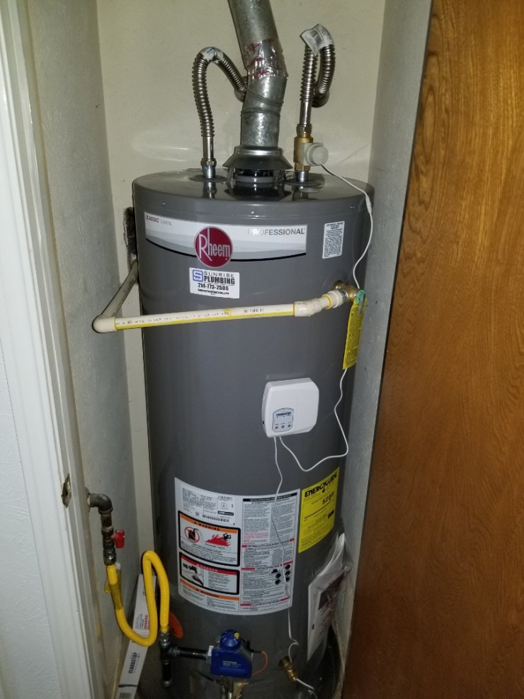 Plano, TX - Water heater and hallway closet is leaking need repair. Install new 50 gallon gas water heater with flood stop device. Plano plumbers