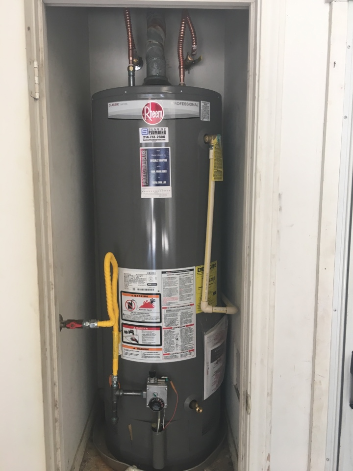 Forney, TX - Bradford white water heater 14 years old will not stay lit, need water heater repair. Homeowner decided to install new Rheem water heater with 10 year parts and labor warranty.