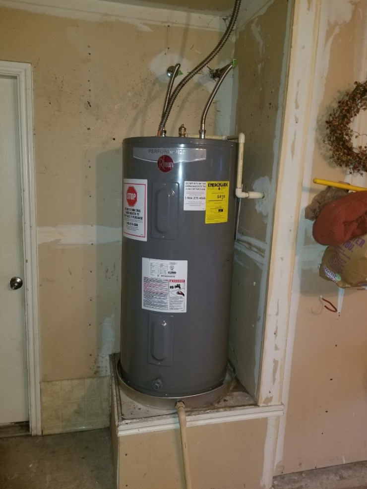 Garland, TX - Water heater  In garage is leaking on top. Need repair. Install new  Client provided water heater. Rockwell plumbers
