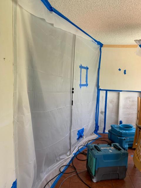 Davie, FL - Water damage and Mold remediation done in her living room by our team of experts