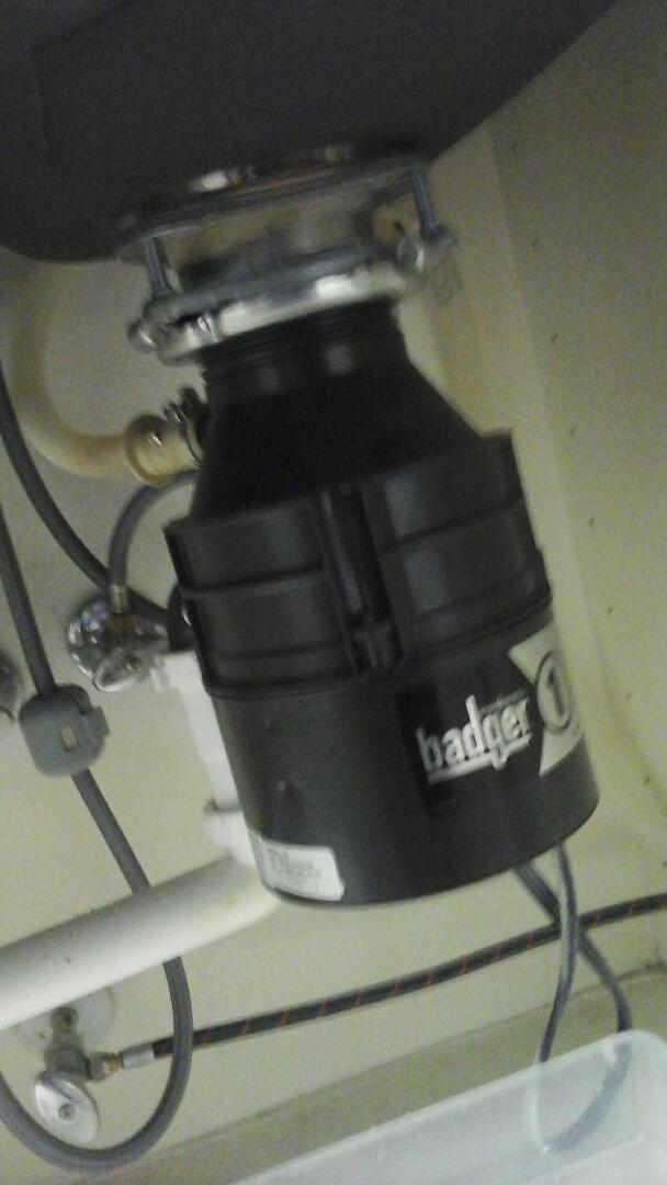 DeSoto, TX - Garbage disposal is leaking from bottom