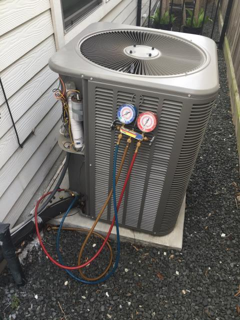 Houston, TX - Repairing an air conditioner in Houston, TX today.
