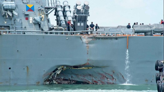 Damage to the hull of the USS John McCain after it collided with an oil tanker in August 2017.