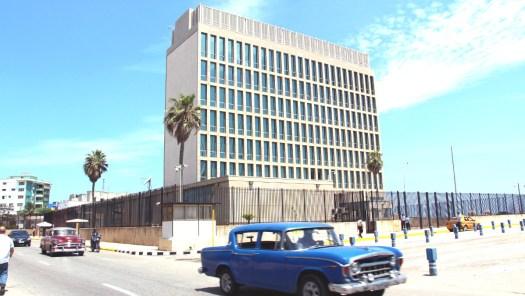 Cars drive past the US Embassy in Havana, Cuba.