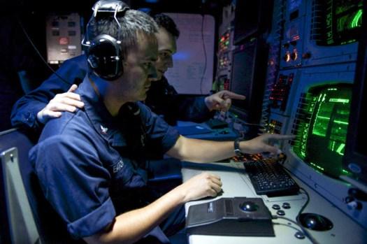 US Navy sailors aboard the <em data-recalc-dims=