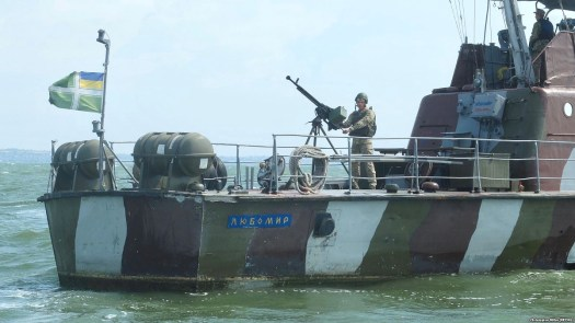 A Ukranian sailor mans a machine gun on the stern of a patrol boat in the Sea of Azov.