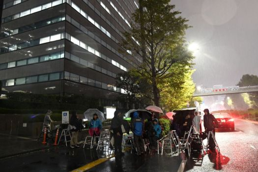 Japanese media stand outside the prosecutor's office after Ghosn's arrest Nov. 19, 2018.