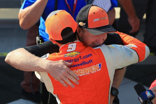 Chase Elliott receives a congratulatory hug from father Bill Elliott after his first-career win at Watkins Glen International on Aug. 5, 2018.