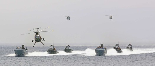 US Navy CCAs lead a formation of RHIBs while US and Jordanian helicopters fly overhead during an iteration of the annual Exercise Eager Lion in Jordan