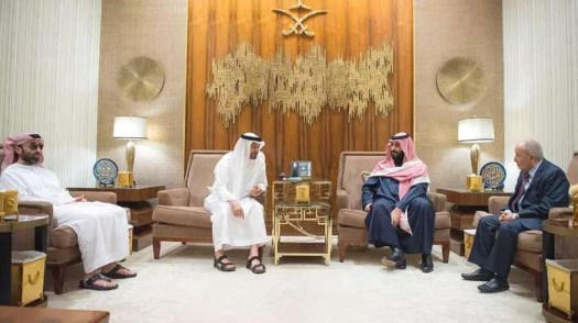 The Crown Prince of Abu Dhabi, one of the United Arab Emirates, Sheik Mohammed bin Zayed Al Nahyan, second from the left, meets with members of Yemen's Al Islah during a meeting organized by Saudi Arabia's Crown Prince Mohammad Bin Salman, to his right, in December 2017.