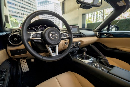 Natty tan leather graces this Grand Touring edition