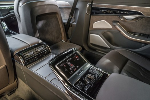 Executive Package perks include a foot-massaging pad and tablet-equipped console