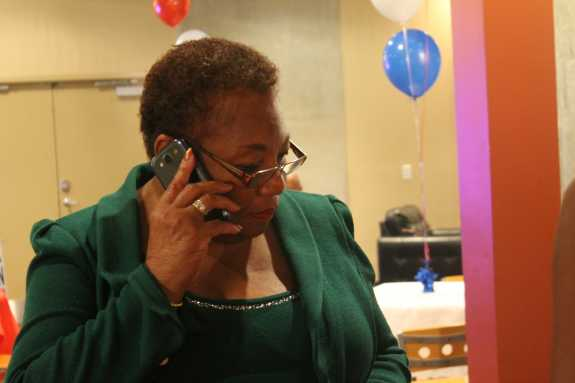State Sen. Geraldine Thompson monitors election results, August 2014. Photo by Amy Green