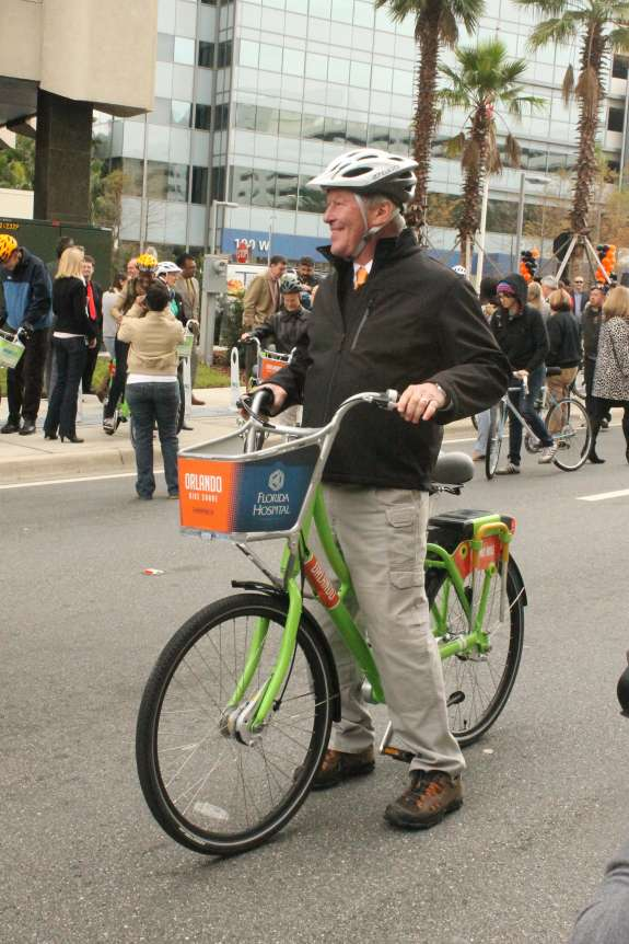Orlando Mayor Buddy Dyer tries out the city's new bike share program