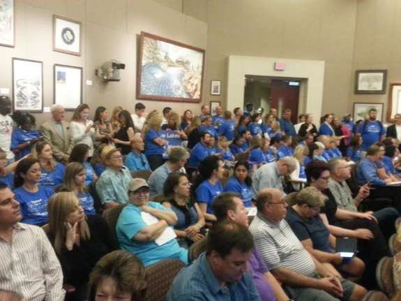 Over one hundred parents, administrators, and homeowners appeared at Tuesday's public hearing on the relief school. Photo: Renata Sago.