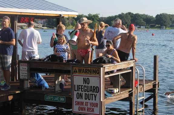 Lucky Meisenheimer directs the swim from his dock on Lake Cane. Photo: Matthew Peddie, WMFE