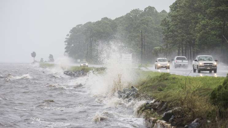 Traffic moves along U.S. Highway 98 in Eastpoint, Fla., ahead of Hermine, which made landfall early Friday.