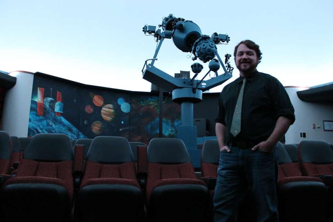 Derek Demeter and the star projector. Photo: Matthew Peddie, WMFE