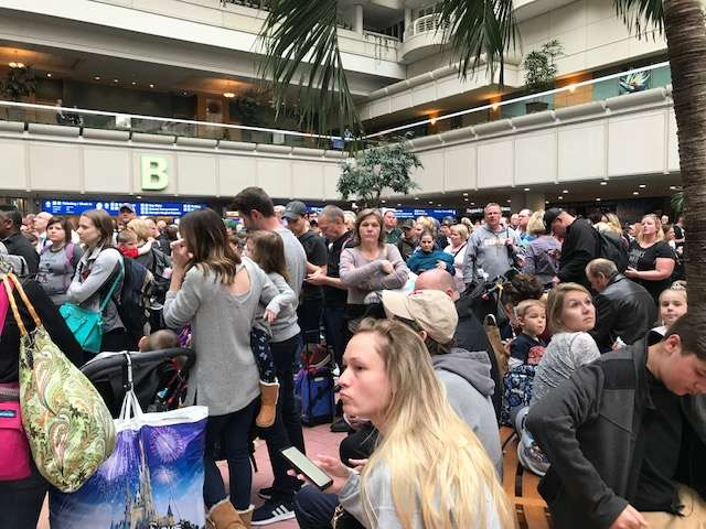 Hundreds of passengers waited at the security check points after an off-duty TSA agent jumped to his death at the Orlando International Airport. Photo: Danielle Prieur