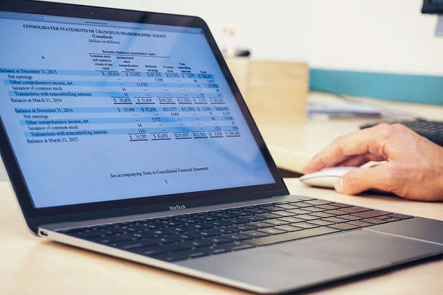 Photo of generic financial report on laptop courtesy of instructionalsolutions.com via Creative Commons