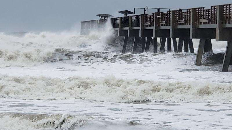 High surf pounds the Jacksonville Beach Pier during Hurricane Dorian on Wednesday.