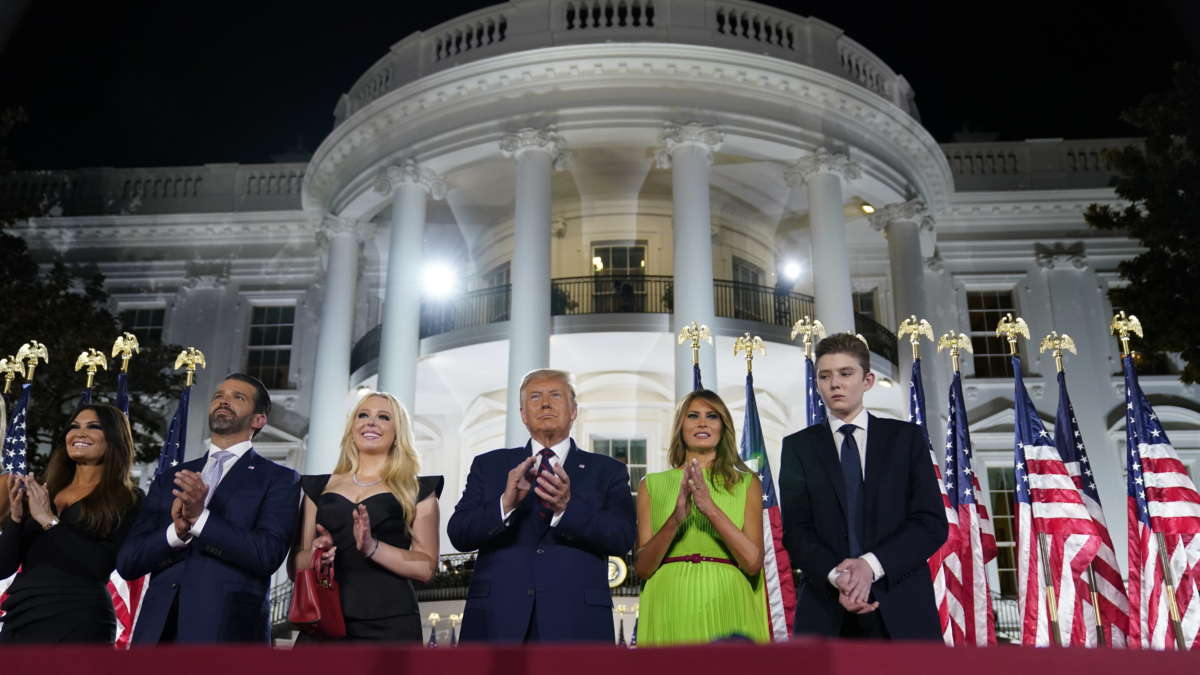 From left, Kimberly Guilfoyle, Donald Trump Jr., Tiffany Trump, President Donald Trump, first lady Melania Trump and Barron Trump stand on the South Lawn of the White House on the fourth day of the Republican National Convention, Thursday, Aug. 27, 2020, in Washington.