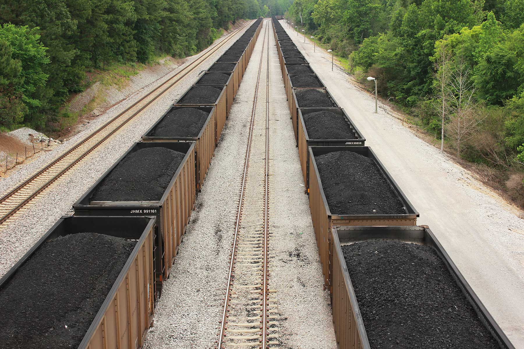At all hours of the day and night massive coal trains deliver the fossil fuel that powers Miller and creates its nation-leading carbon output.