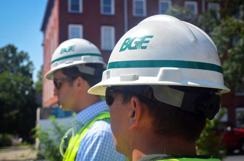 BGE workers look on as an upgraded natural gas pipe is installed in Baltimore's Franklin Square neighborhood on July 31, 2017.