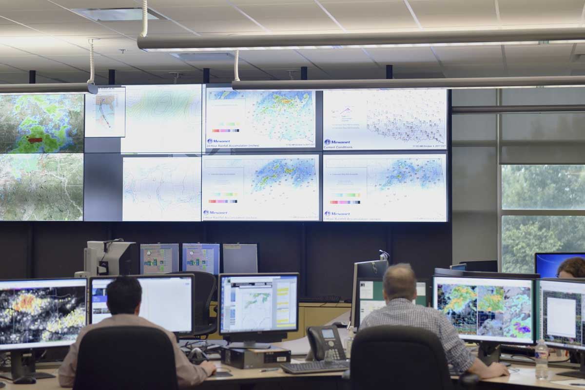 Screens display Mesonet data in the local forecasting office at the National Weather Center in Norman.