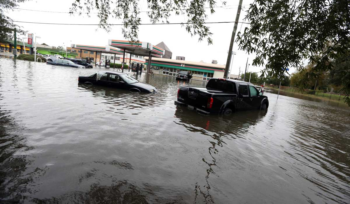 Flooded cars in Norfolk, Virginia, after heavy rains and high tides from the remnants of Hurricane Matthew in 2016. (Steve Earley/The Virginian-Pilot via AP)