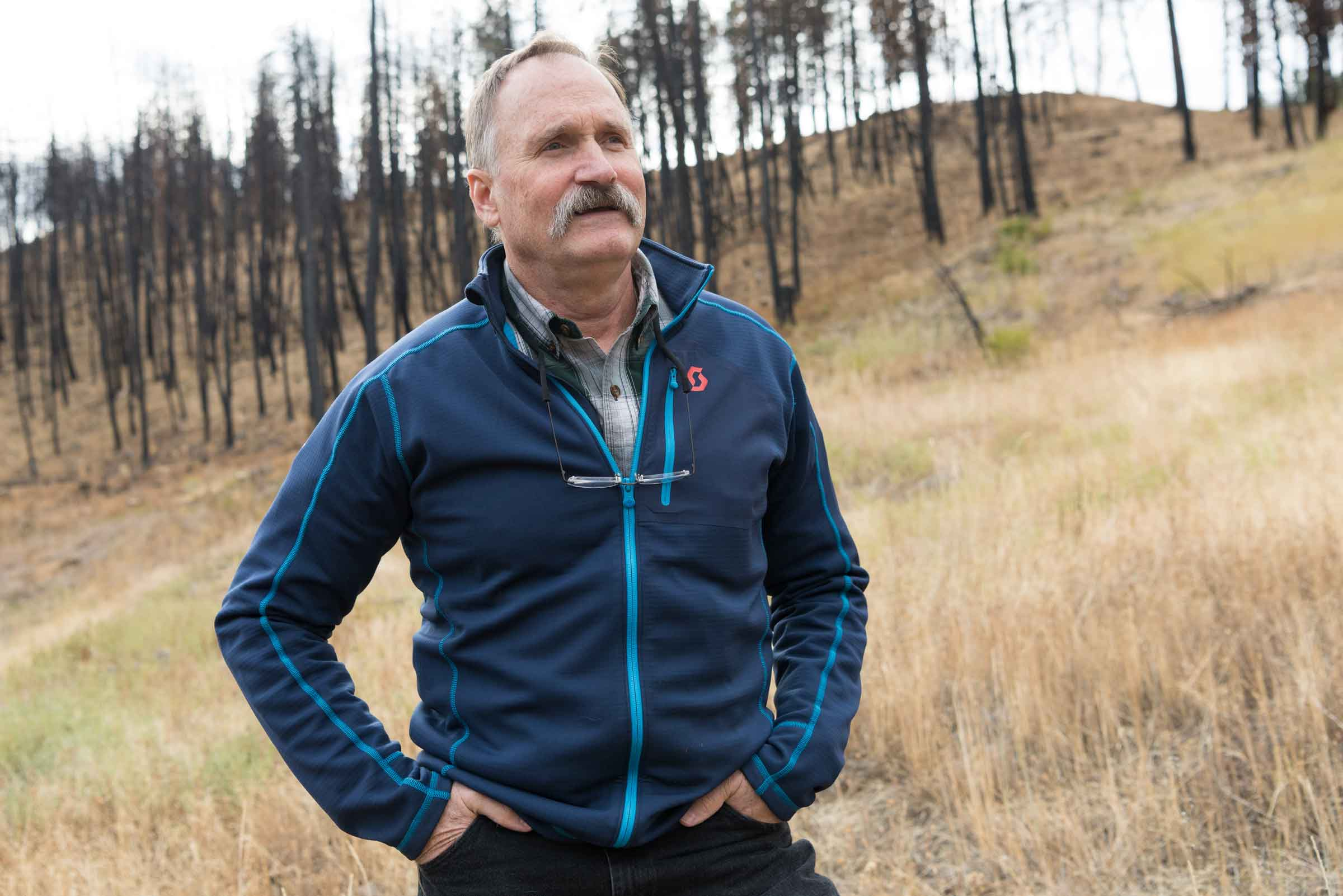 "Paul Hessburg ponders solutions to the megafire epidemic as he stands on land burned by the 2015 Canyon Creek Complex megafire south of John Day. ""Burn under the right conditions is a big core of the answer,"" he says. ""We're not going to [mechanically] thin our way out of this problem. There isn't enough time. It's changing the landscape too fast."" (Adam Bacher)"