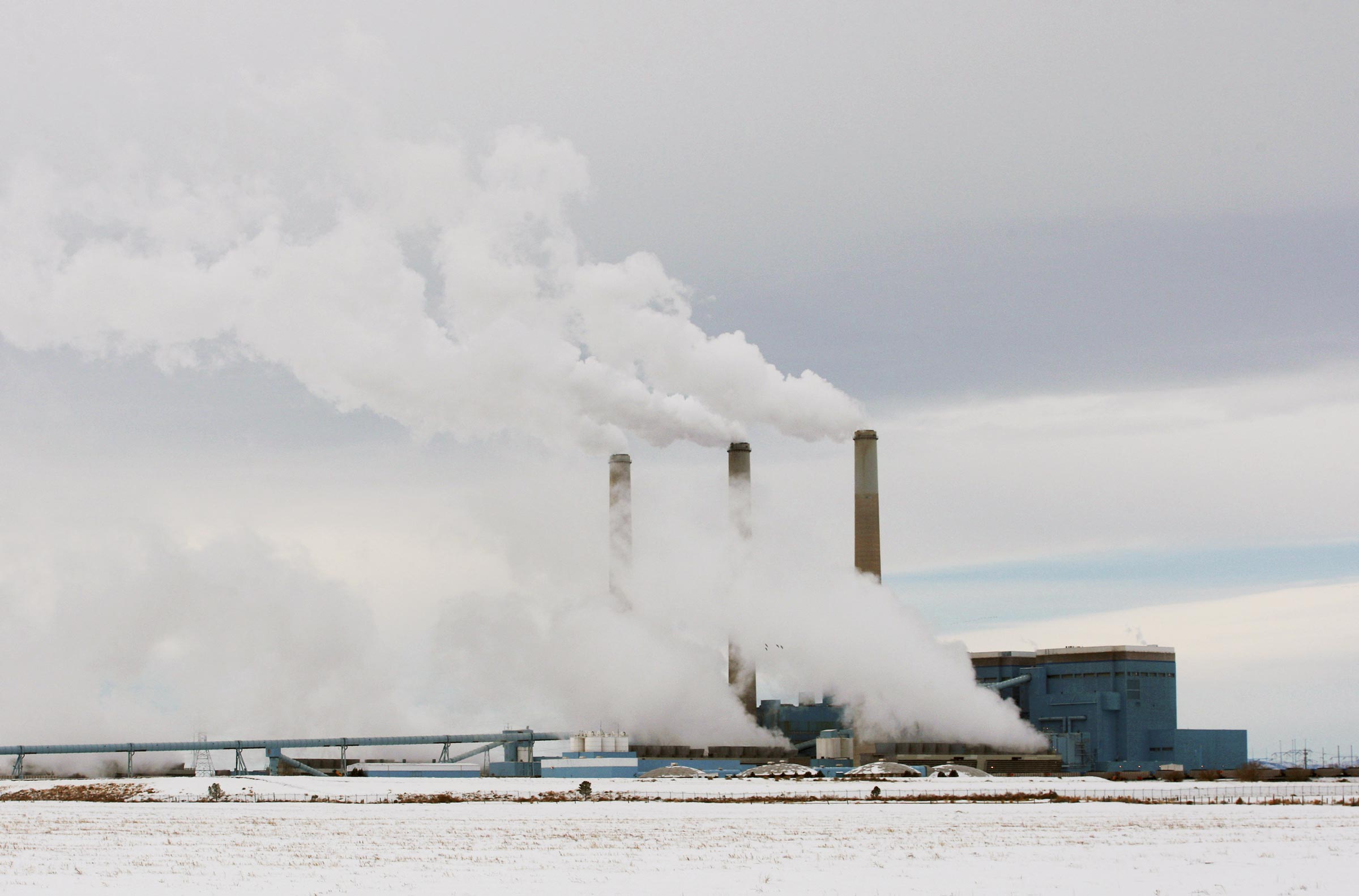 In this Feb. 11, 2014, file photo, steam rises from the stacks of Basin Electric's Laramie River Station coal-fired power plant near Wheatland, Wyo. (AP Photo/The Casper Star-Tribune, Alan Rogers)