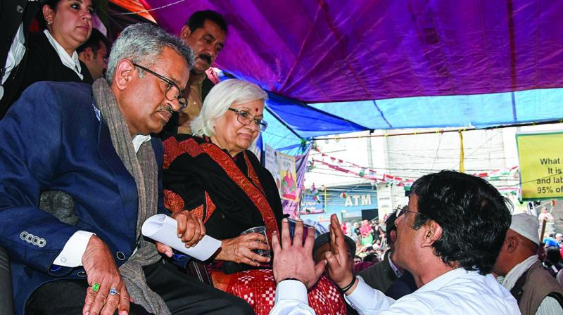 Supreme Court-appointed interlocutors, advocates Sanjay Hedge and Sadhana Ramachandran, during  their visit to Shaheen Bagh to initiate talks with the protesters demonstrating against the Citizenship (Amendment) Act and National Register of Citizens in New Delhi on Thursday. (Photo: PTI)