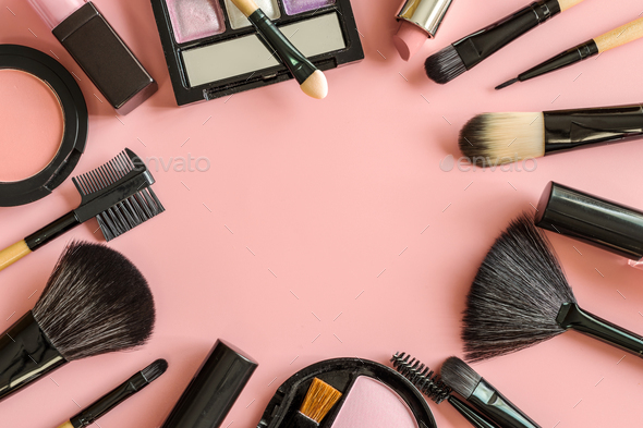 Set of make up brushes and cosmetics on pink background Stock Photo     Set of make up brushes and cosmetics on pink background Stock Photo by  kitzstocker