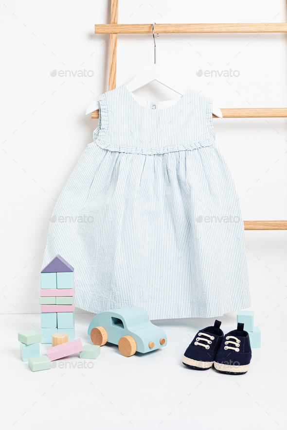 https photodune net item cute baby clothes hanging on the rack 30220908