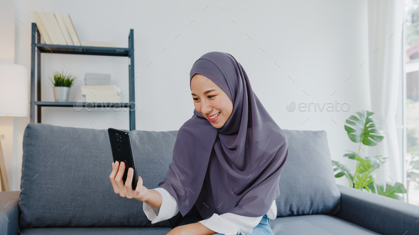Photo of a young couple is being shared to insinuate that a hindu man married a muslim woman. Asia Muslim Lady Wear Hijab Using Phone Video Call Talking With Couple At Home Stock Photo By Tirachard