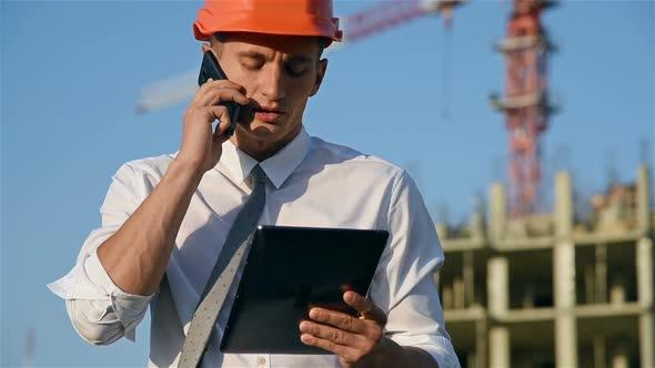 Engineer Speaks On Mobile Phone